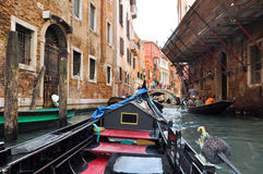 VENICE-JUNE 15: Gondola on the Venetian canal on June 15, 2012 in Venice, Italy. Royalty Free Stock Photo