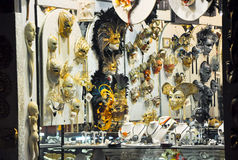 VENICE-JUNE 15: Venetian masks in a display case on June 15, 2012 in Venice, Italy. Stock Photography