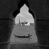 Venice Through a Keyhole. A black and white keyhole view of a gondola and St. Georges Island in Venice, Italy. (This shot was actually taken looking through the Royalty Free Stock Photos