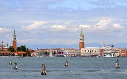 Venice lagoon with bell tower of St. Mark and St. George Stock Images