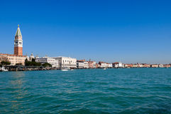Venice lagoon with Doge's palace and Campanile on Piazza di San Stock Photos