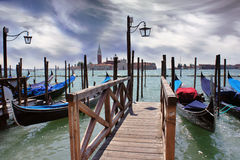 Venice lagoon. Gondolas moored by Saint Mark square Royalty Free Stock Image