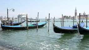 Venice lagoon, ocean cruise liner, gondolas anchored and an intense sea traffic. A panoramic view to the Venice lagoon pier with lot of gondolas anchored at stock footage