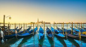 Venice lagoon, San Giorgio church, gondolas and poles. Italy royalty free stock photos