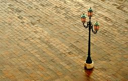 Venice Lamp Post. Lamp post on cobblestone pavement in Venice Royalty Free Stock Photography