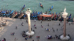 Venice Landmark, Aerial View of columns carrying the two patron saints of Venice with covered gondolas in lagoon background stock video footage