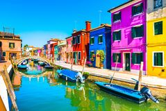 Venice landmark, Burano island canal, bridge, colorful houses an. D boats, Italy, Europe Stock Image