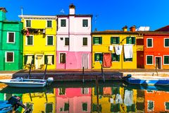 Venice landmark, Burano island canal, colorful houses and boats, Royalty Free Stock Images
