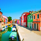 Venice landmark, Burano island canal, colorful houses and boats, Royalty Free Stock Photos