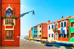Venice landmark, Burano island canal, colorful houses and boats, Royalty Free Stock Photo