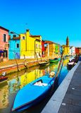 Venice landmark, Burano island canal, colorful houses and boats, Royalty Free Stock Image