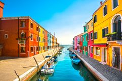 Venice landmark, Burano island canal, colorful houses and boats, Stock Images