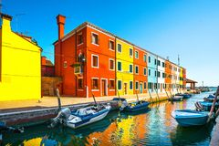 Venice landmark, Burano island canal, colorful houses and boats,. Italy Europe Stock Photos