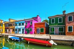 Venice landmark, Burano island canal, colorful houses and boats,. Italy. Europe Royalty Free Stock Image