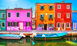 Venice landmark, Burano island canal, colorful houses and boats,. Italy. Europe Stock Photos