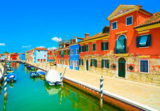 Venice landmark, Burano island canal, colorful houses and boats, Stock Image