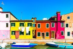 Venice landmark, Burano island canal, colorful houses and boats,. Italy. Europe Stock Images