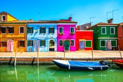 Venice landmark, Burano island canal, colorful houses and boats,. Italy. Europe Royalty Free Stock Photos