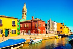 Venice landmark, Burano island canal, colorful houses, church an royalty free stock image