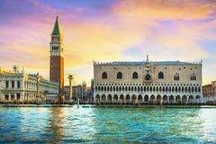 Venice landmark at dawn, Piazza San Marco with Campanile and Doge Palace. Italy. Venice landmark at dawn, view from sea of Piazza San Marco or st Mark square royalty free stock photos