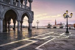 Venice landmark at dawn, Piazza San Marco, Doge Palace and San G. Venice landmark at dawn, view of Piazza San Marco or st Mark square, San Giorgio church and Royalty Free Stock Images
