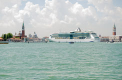 Venice with large Cruise Ship. VENICE, ITALY - JUNE 6: The large cruise ship Serenade of the Seas sailing into Venice on June 6 2013.  There have been many Royalty Free Stock Photo