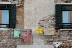 Venice, laundry between two windows Stock Images