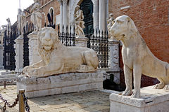 Venice Lions, Italy. Marble lion statues, including the Piraeus Lion, on display outside the Venetian Arsenal, Venice, Italy stock photo