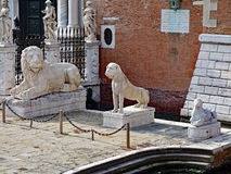 Venice Lions, Italy. Marble lion statues, including the Piraeus Lion, on display outside the Venetian Arsenal, Venice, Italy royalty free stock photo