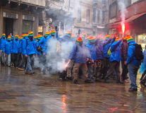 Venice, March 03 2015: anti capitalist demonstrators on the stre. Ets in venice with masks and flares with smoke Stock Photography