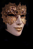 Venice mask. Golden venice mask with black background Stock Image