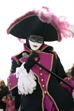 Venice mask. A masked person in Venice in black, orange  and white mask costume on a 2010 Venice carnival which became traditional event Royalty Free Stock Image