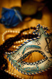 Venice mask. Ornate carnival mask on a music paper with rose and pearls Stock Photography