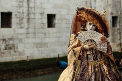 Venice Mask. Masked person at the Venice Carnival 2014 Royalty Free Stock Photography