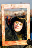 Venice Mask, Carnival. Strange old mask with frame, Venice, Italy Stock Images
