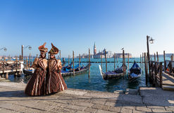 Venice mask, Carnival with gondolas and seascape background. Venice mask during Carnival with gondolas and seascape background royalty free stock photography