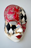 Venice mask on a light background. Red white black Venetian mask on a light background Royalty Free Stock Photos