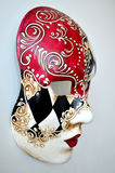 Venice mask on a light background. Red white black Venetian mask on a light background Stock Image