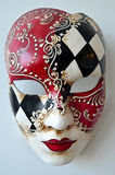 Venice mask on a light background. Red white black Venetian mask on a light background Royalty Free Stock Photo