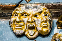 Venice mask of triple face happy, angry and sad. Original unique golden color Venice mask of three faces happy, angry and sad merged into one Stock Image