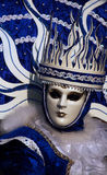 Venice: masked and crowned. Venice carnival, winter mask in white and blue Stock Photos