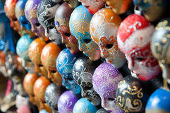 Venice masks. Row of colorful Venice masks figures looking down