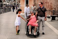 VENICE, MESTRE-June 29, 2014: Disabled grandmother in a wheelcha Stock Images