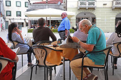 VENICE, MESTRE-June 29, 2014. Elderly man reading a newspaper in Stock Photos