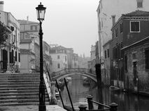 Venice Mist. Black and white image of venice canal in the rain and mist stock photo