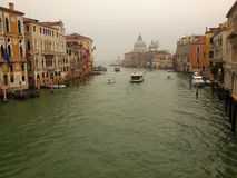 Venice in the Mists. The Grand Canal of Venice on a rainy day with the dome of the Basilica Santa Maria della Salute in the distance Royalty Free Stock Images