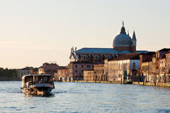 Venice in the morning. Small ship in Venice at the early morning Stock Photos