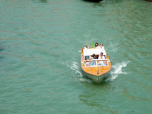 Venice motorboat taxi. VENICE, ITALY - JULY 6, 2015: Wooden motorboat photographed in Venice channels stock images