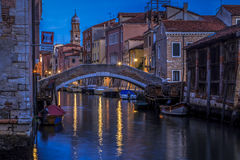 Venice, near the gondola boatyard. Some boats on a canal very early in the morning Royalty Free Stock Image