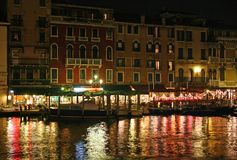 Venice night. Venice restaurant next to the Grand Canal Royalty Free Stock Photos